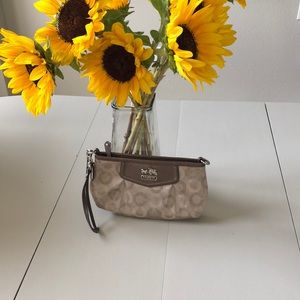 Coach beige brown wristlet with leather detail